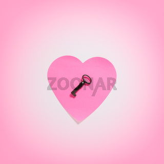 Paper heart with key in pink fog