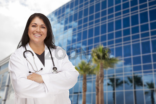 Attractive Hispanic Doctor or Nurse in Front of Building