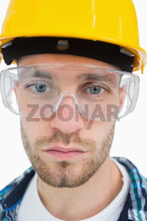 Closeup of architect wearing protective eyewear and hardhat