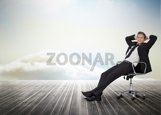 Smiling businessman sitting in a swivel chair