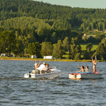 Young people having fun on motorboats