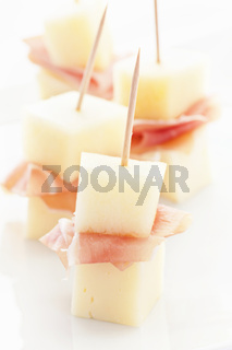 Canape with melon and proscuitto