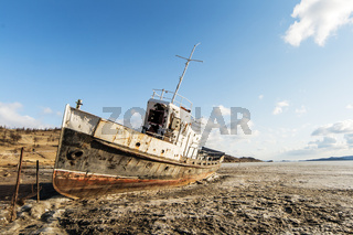 The lonely ship frozen in ices of Lake Baikal
