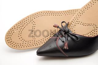 Einlegesohle mit Schuh