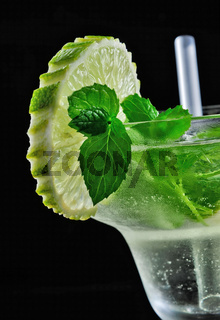 Alcohol drink, cocktail with mint, lemon, straw, isolated black