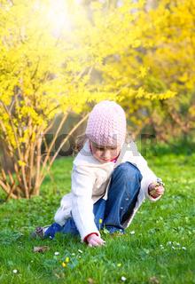 small girl in spring park