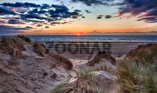 Sunset over Formby Beach through dunes