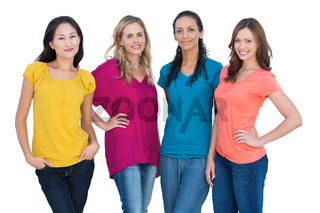 Cheerful models posing with hands on hips