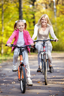 Mother and daughter on bicycle