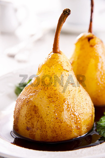 pears cooked in wine with chocolate sauce