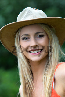 Beautiful smiling woman in a hat