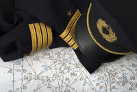 Captain uniform and navigation chart