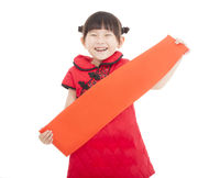 happy chinese new year. smiling asian little girl holding blank red couplets