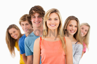 Group standing behind one another at varied angles