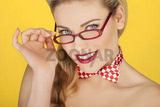 Beautiful blonde in a glasses and a bowtie