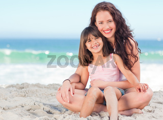 Little girl with her mother at the beach