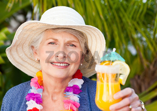 Retired woman drinking a cocktail under the sun