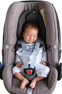 Cute newborn smiling in car seat