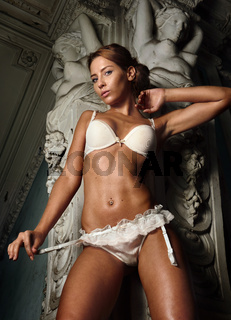 beautiful woman in white underwear in palace
