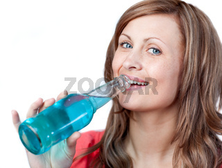 Portrait of a beautiful woman drinking against a white background
