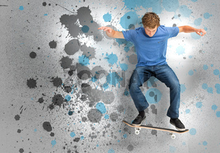 Male skateboarder doing an ollie trick