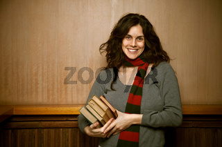 Young College Woman at School With Her books