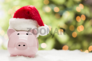 Pink Piggy Bank with Santa Hat on Snowflakes