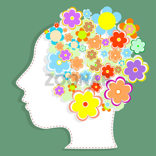 silhouette of a woman's head filled with cute flowers