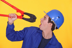 Man holding bolt cutters