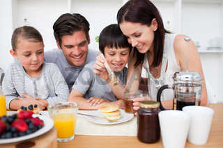 Happy family having breakfast together