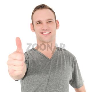 Smiling man showing thumb up