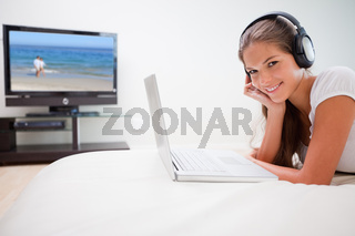 Woman listening to music on her notebook