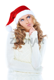 Woman in Santa Claus hat deeply deeply thinking
