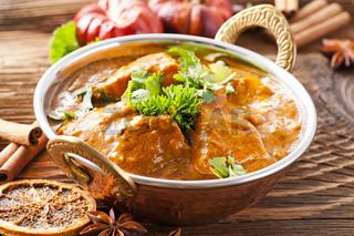 fish curry in copper pot