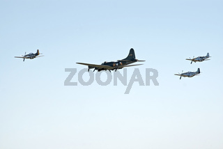 B-17 escorted by three P-51s