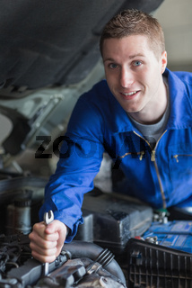 Man working on car engine