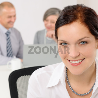 Smiling attractive businesswoman in office closeup