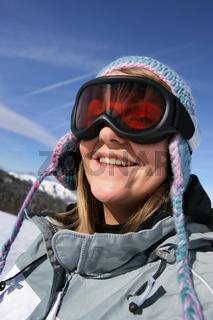 Young woman in ski goggles