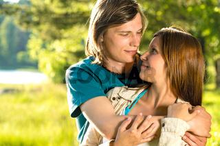 Portrait of hugging caucasian couple outdoors