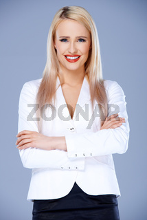 Smiling business woman posing with arms crossed