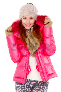 Young woman wearing winter jacket scarf and cap