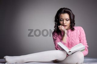 Beauty woman in dark read scare book