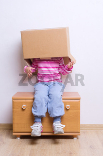 Little girl with cardboard boxes