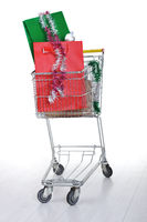 Shopping trolley cart with present boxes and bags