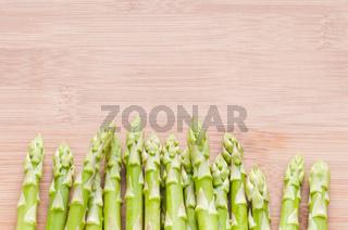 Asparagus bundle on wooden background