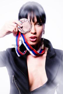 Beautiful stylish woman holding a medal