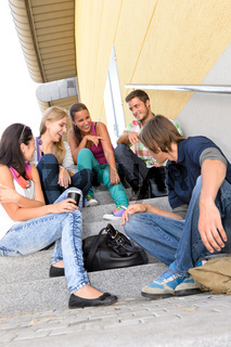 Students laughing on school stairs in break