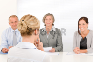 Job interview young woman with business team