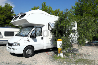 Camper parked at see, near a road in Dalmatia