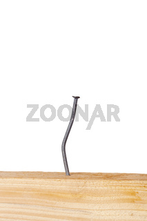 Wooden board with nails